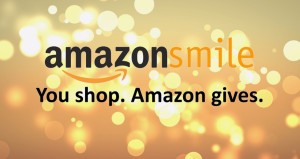 lights background with text: amazon smile you shop. amazon gives
